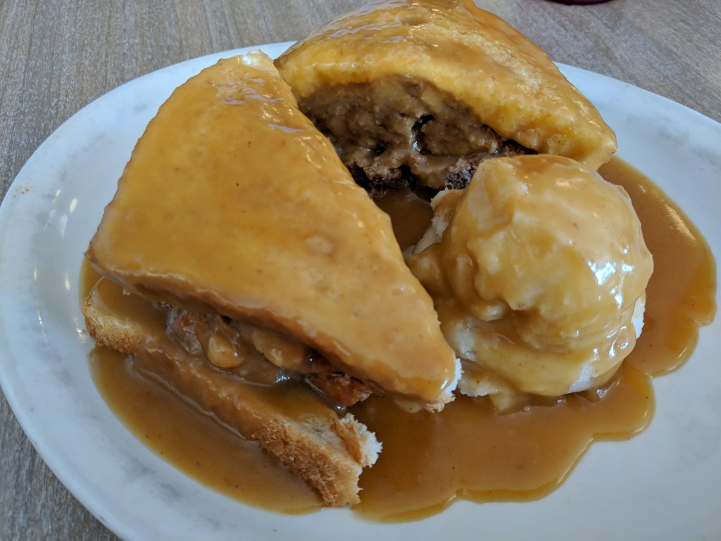 A hot meatloaf sandwich with gravy and mashed potatoes from Hygrade Deli in Detroit