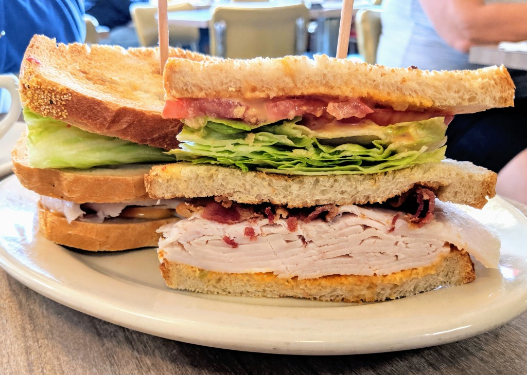 Triple-decker turkey and bacon sandwich with lettuce, tomato, and Russian dressing on rye from Hygrade Deli in Detroit