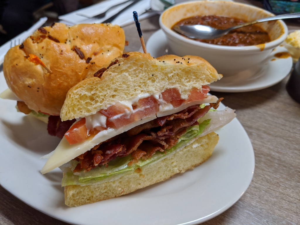 A BLT sandwich with swiss cheese on an onion roll at Hygrade Deli in Detroit